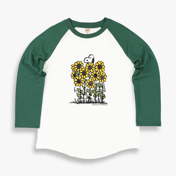 TSPTR Sunflowers Raglan T-Shirt. White shirt with green sleeves. It has a design of Snoopy in a field of tall sunflowers.  Edit alt text