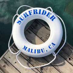 White lifesaver with the words Surfrider Malibu, CA in blue around it.