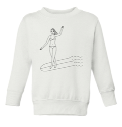 Kids white sweatshirt by Gracias california. There a woman in a bikini on a surfboard doing a cross step.