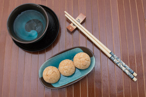 chopsticks and turquoise teacup