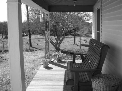 The front porch of the farmhouse.