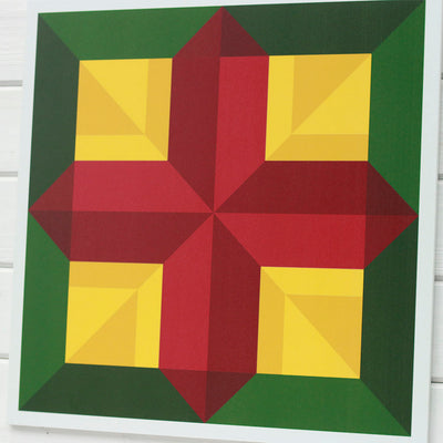 Cross barn quilt for sale with maroon cross on gold and green border