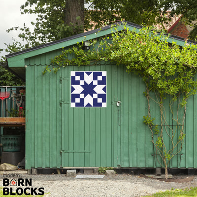 Navy blue star barn quilt block on green garden shed