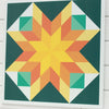 New barn quilt from Put a Quilt on It in dark green and warm shades of yellow
