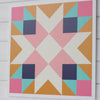 Sedona Barn Quilt with shades of warm gold, navy, teal and pink