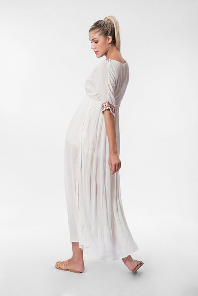 Embroidered long white dress with wrap-style