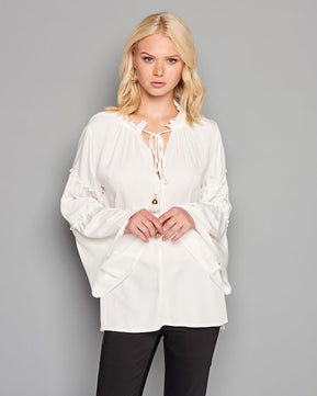White flowing blouse by Nejma
