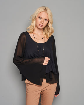 Ruffle-trimmed black blouse
