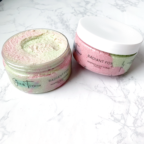 pastel green and pink whipped sugar scrub packed in a low profile clear jar and white cap