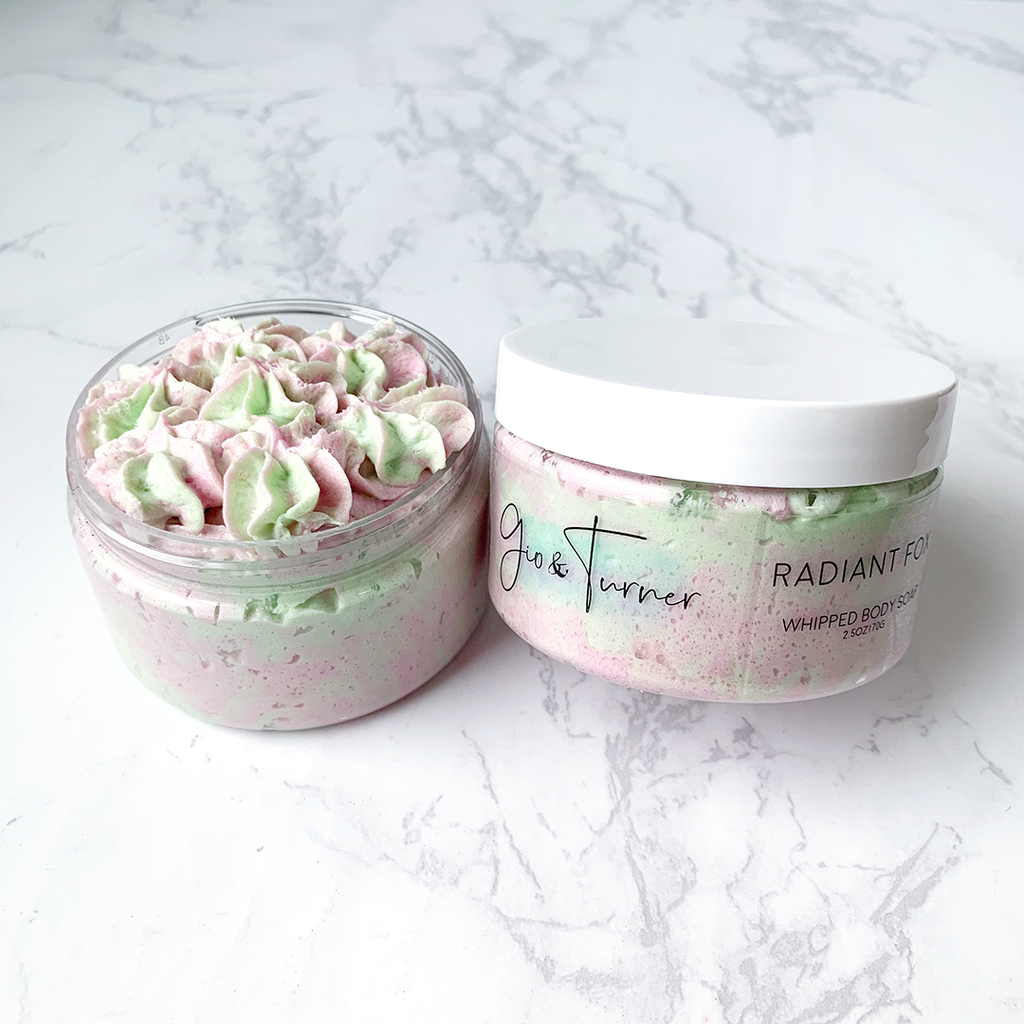 pastel green and pink whipped soap packaged in a clear low profile jar and white cap