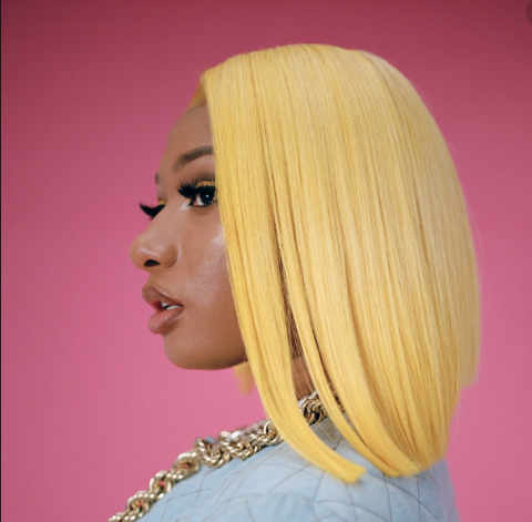 Megan aka Meg the Stallion in yellow blonde blunt cut bob wig