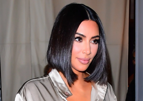 Kim Kardashian West in Short Bob with dark hair and middle part hairstlyle