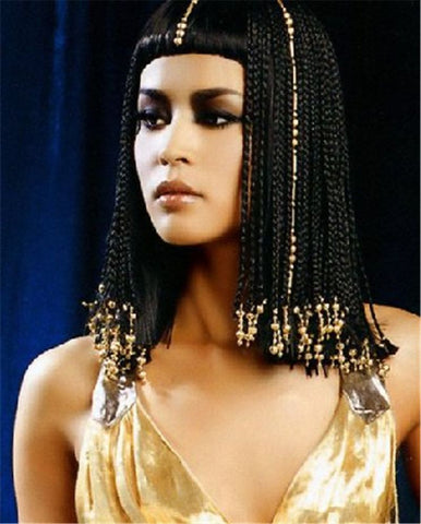 cleopatra wearing a hair weave wig with braids and a bang