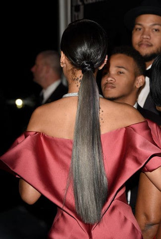 Rihanna Rih Rih in red satin dress sleek hair pulled back Diamond ball