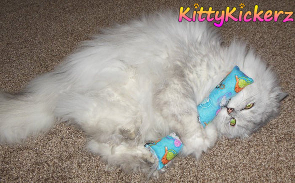 Kicker Stick Organic Catnip Cat Toy Handmade in USA by Kitty Kickerz Best Cat Toy Popular Catnip Toy Top Rated Kitties on Pink Fabric