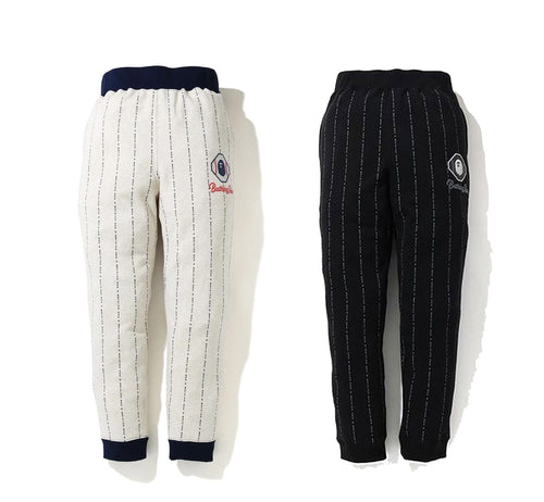 A BATHING APE TEXT STRIPE SWEAT PANTS