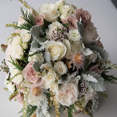 Mudgee Monkey is a local based florist in the Mudgee Area. Pictured is a large bouquet of fresh pastel, local Mudgee flowers.