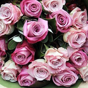 Mudgee florist Mudgee Monkey is a local based florist in the Mudgee Area. Pictured is a generous bouquet row mixed pink roses Valentines day Free delivery and mothers day