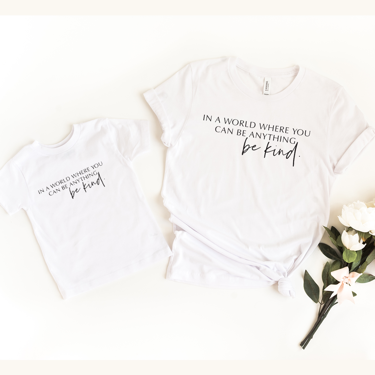 In a world where you can be anything ... Be Kind White T-Shirts