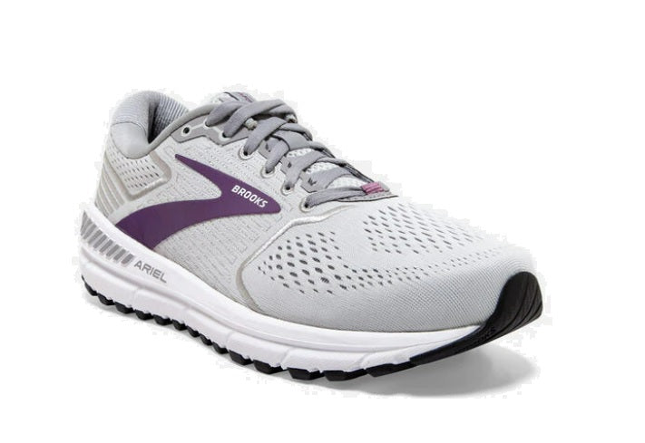 Light greyish white brooks athletic shoe with purple swish