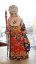Decorative santa with berries