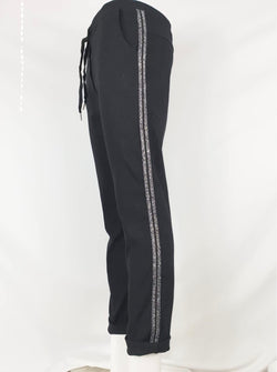 Black magic trousers with silver stripes