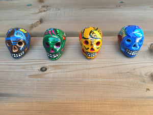 Six (6) Miniature Ceramic Sugar skulls with strings, assorted colours