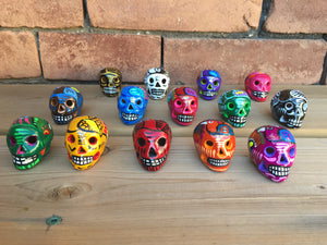 Four (4) Miniature Ceramic Sugar skulls with strings, assorted colours (in stock)