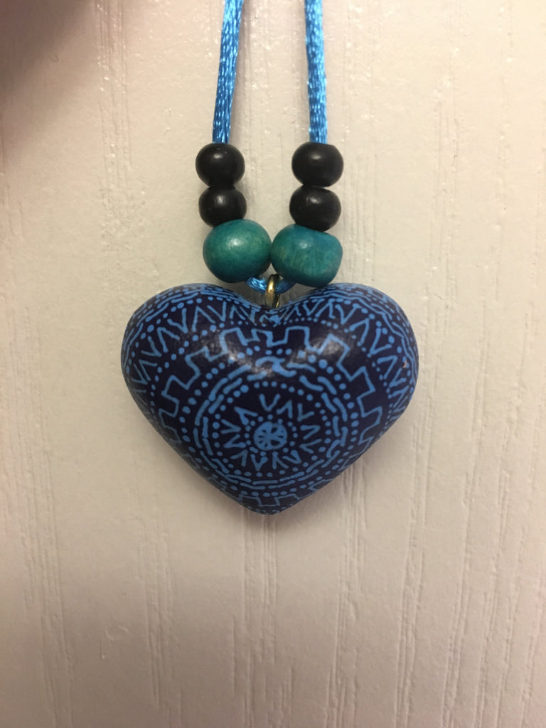 Heart-shaped pendant.