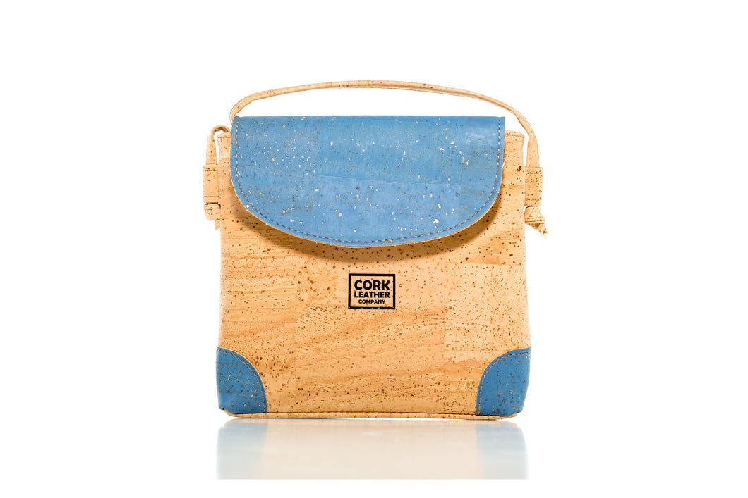 blue and beige cork leather company crossbody bag with button flap and zipper enclosure