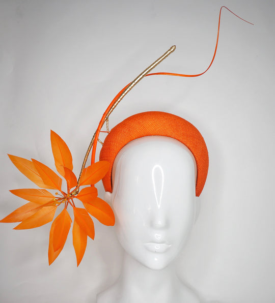 Fireworks - Orange straw base with sculpted quills and leather starburst.