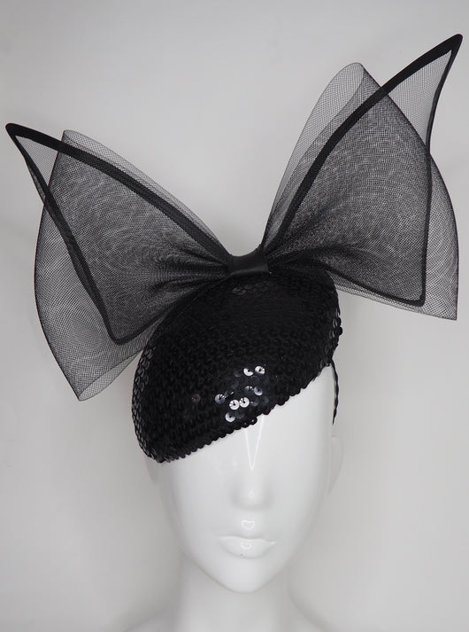 Sequin Sass - Black wired crinoline bow on a sequin facehugger base
