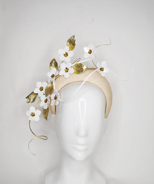 Blossom - White cherry blossoms on a natural straw 3D base with gold and white quills.