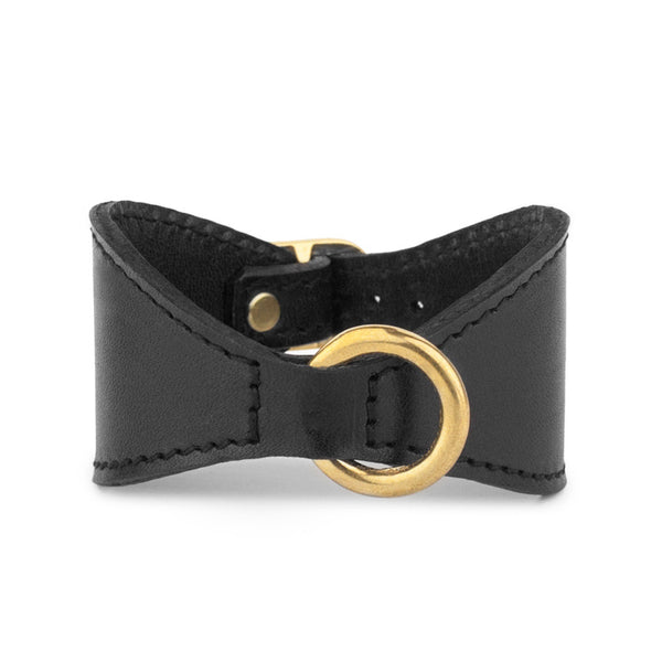 djustable tapered leather cuff with brass ring front view
