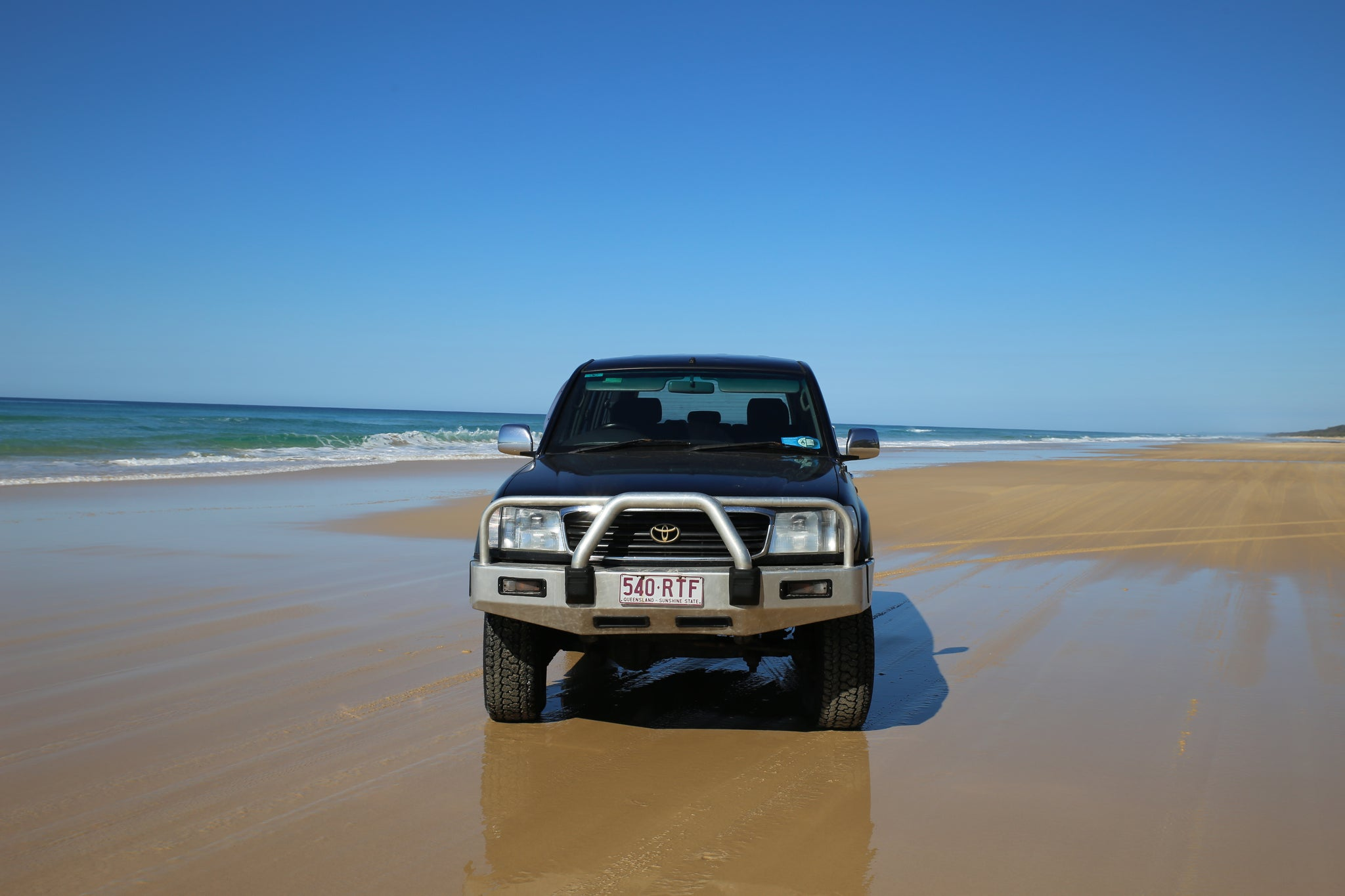 Fraser Island beach with Landcruiser 100
