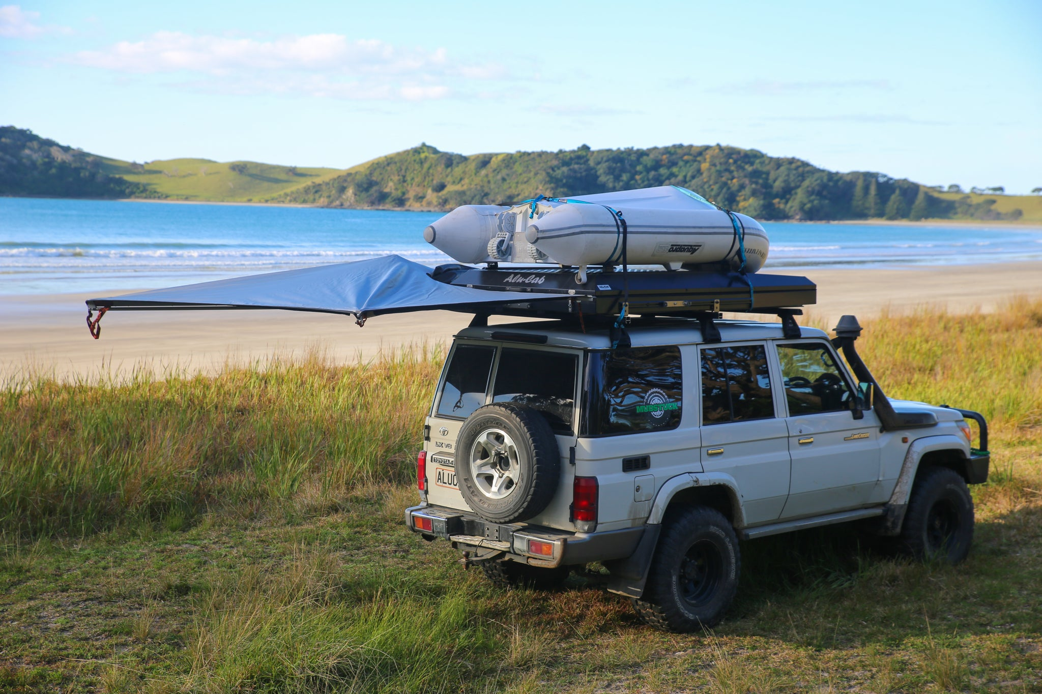 Mudstuck Alu-Cab Gen3 roof top tent and Shawdow Awning with a Landcruiser 76