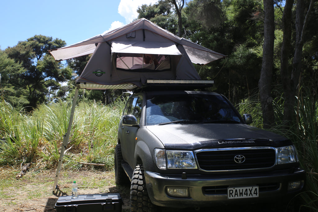 Mudstuck roof top tent with LC100 series