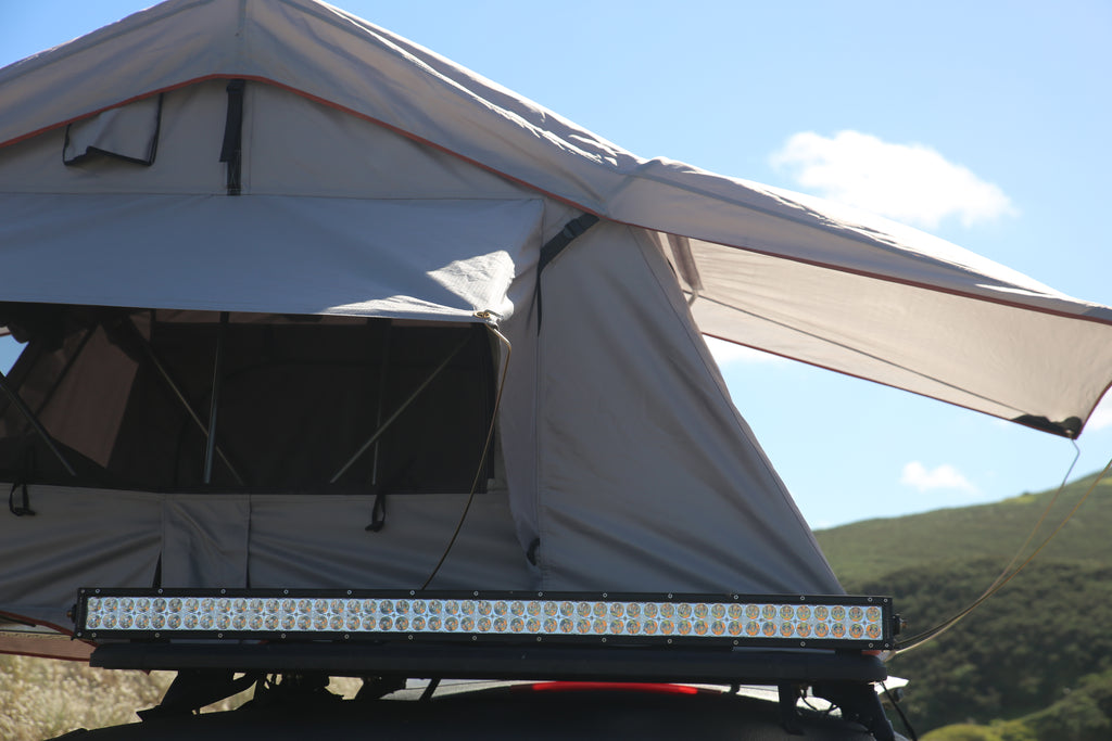 Mudstuck roof top tent and LED light bar