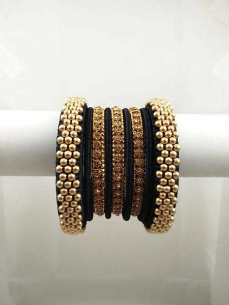 Lovely set of bangles, black and gold