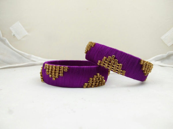 Pair of purple and gold (silk) bangles, B13
