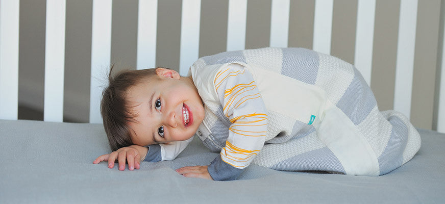 What should my baby wear under their sleeping bag or swaddle?