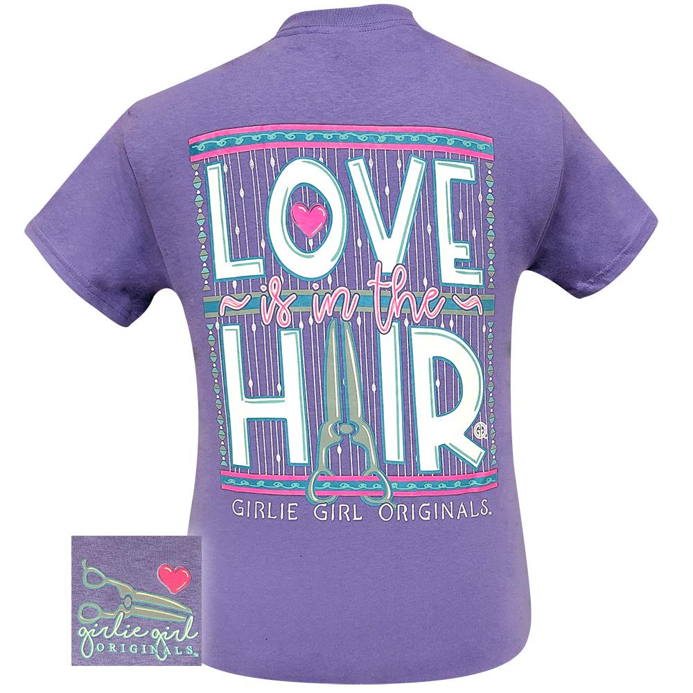Back view of violet colored short sleeve women's tee with a graphic saying
