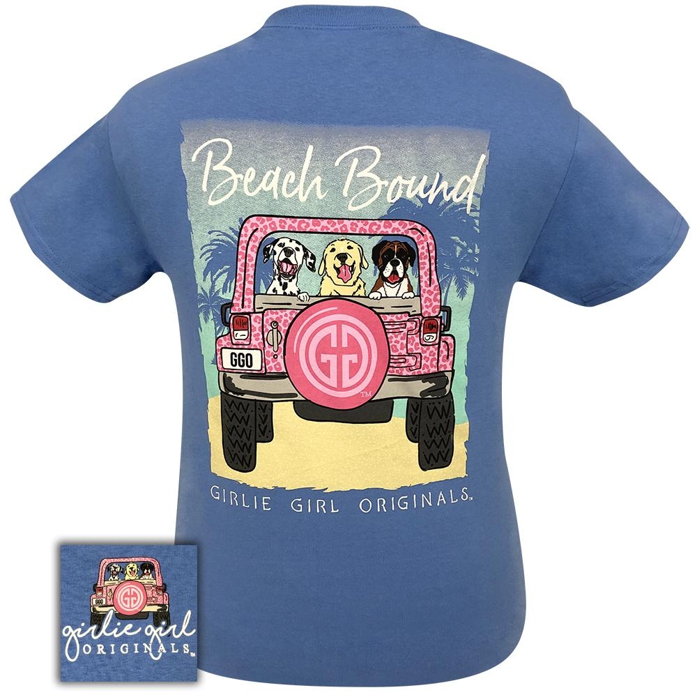 Back of short sleeve women's shirt with the graphic of three dogs in the back of a car headed to the beach with the words