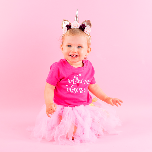 'Unicorn obsessed' baby shortsleeve shirt