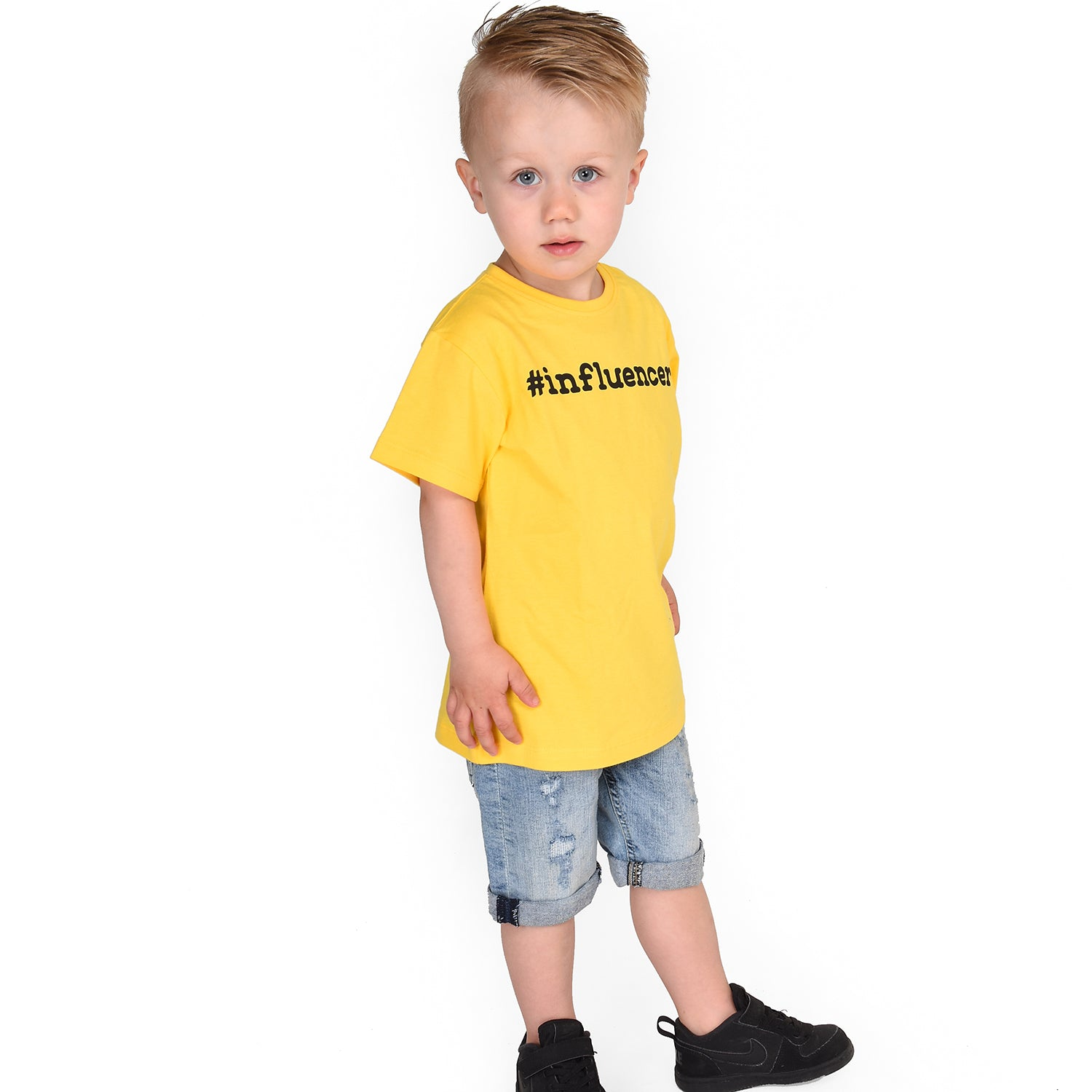 Blonde boy with yellow shirt, with '#influencer' print, by KMLeon.
