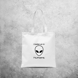 'I believe in humans' tote bag