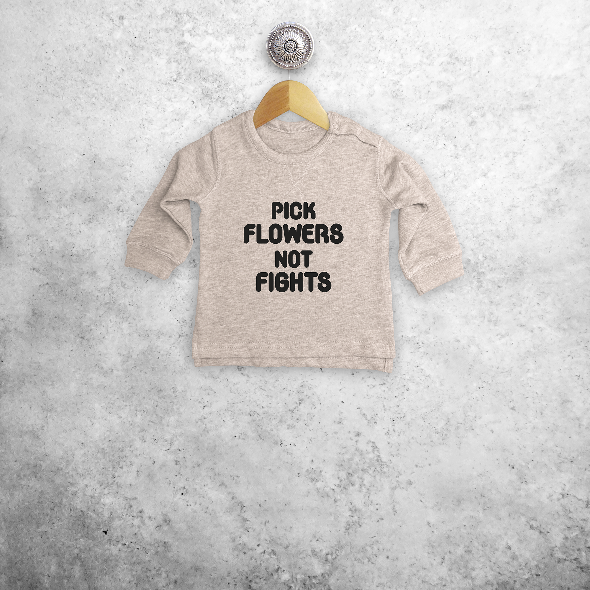 'Pick flowers not fights' baby sweater