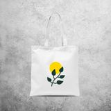 Plant and sun tote bag