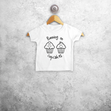 'Running on cupcakes' baby shortsleeve shirt