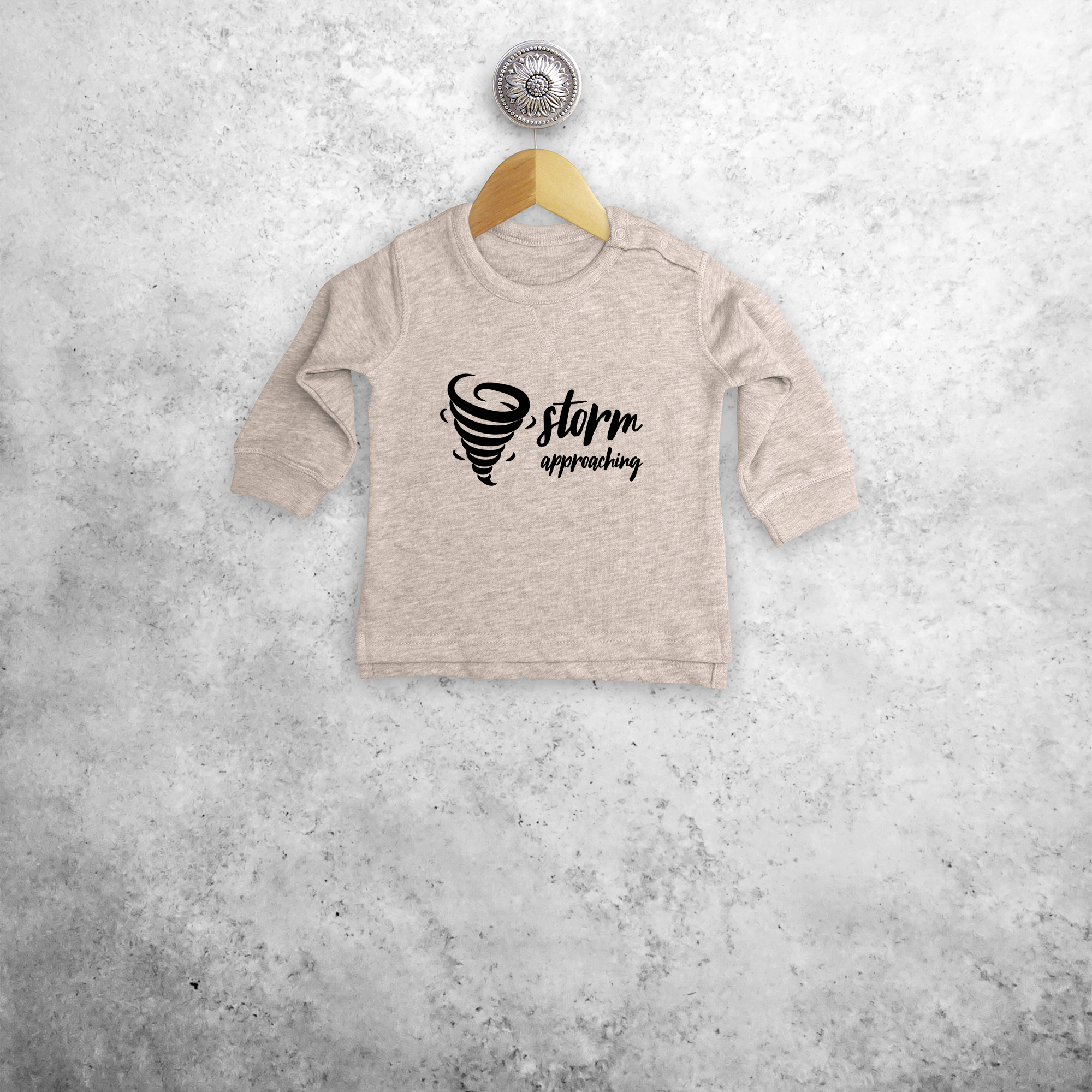 'Storm approaching' baby sweater